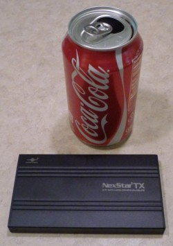 Here's the enclosure with a Coke can to give you an idea how small it is.